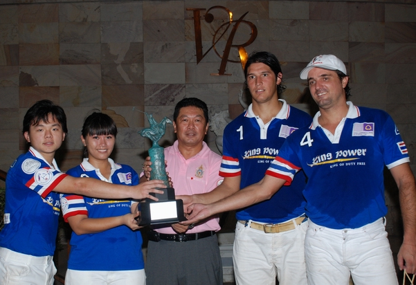 Thai Polo League Champions -- Captain Ploy receiving the trophy from her father Khun Bhinsaeng Kanoksakdi.