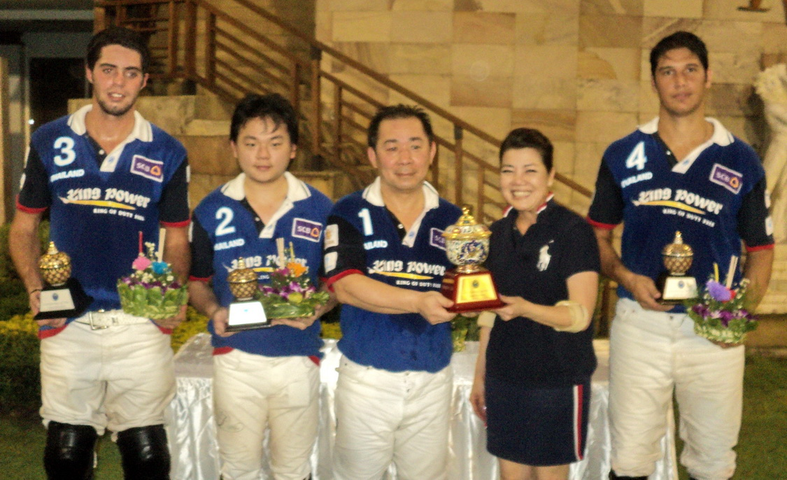 Khun Vichai presented winning trophy by Khun Tuk